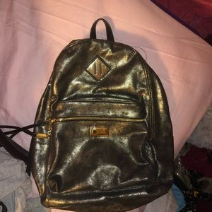 Juícy Couture black and gold backpack